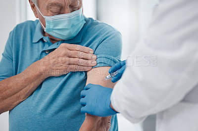 Buy stock photo Cropped shot of a handsome senior man getting his covid 19 vaccine