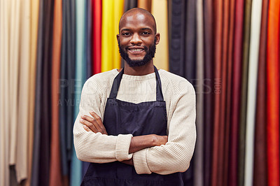 Buy stock photo Shot of a young man working at his job in a shop