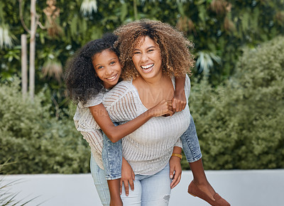 Buy stock photo Shot of a mother carrying her daughter outside