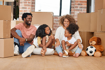 Buy stock photo Shot of a family sitting on the floor in their new home