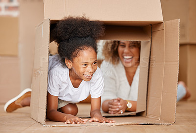 Buy stock photo shot of a mother playing with her daughter in a box at home