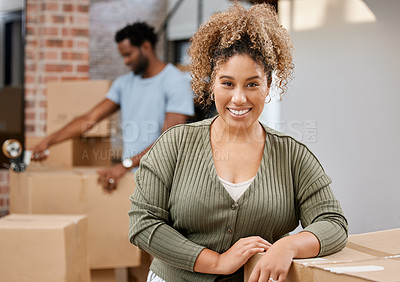 Buy stock photo Shot of a woman leaning on boxes at home