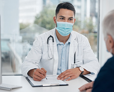 Buy stock photo Shot of a young doctor talking to a patient in an office