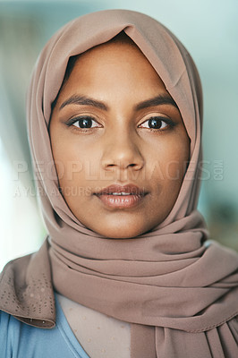 Buy stock photo Shot of a young muslim woman sitting in the loung at home