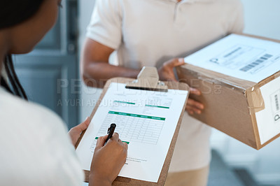 Buy stock photo Shot of an unrecognizable woman signing a form for a delivery