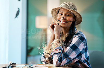 Buy stock photo Shot of a young woman applying halloween makeup at home