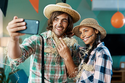 Buy stock photo Shot of a young couple taking a selfie at a home