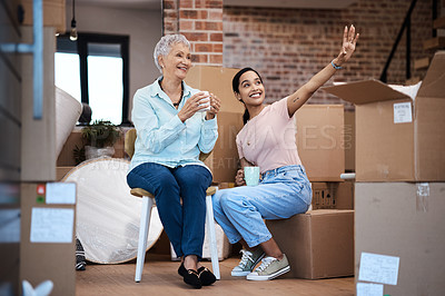 Buy stock photo Shot of a senior woman moving house with help from her daughter
