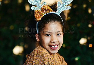 Buy stock photo Portrait of a cute little girl celebrating Christmas at home