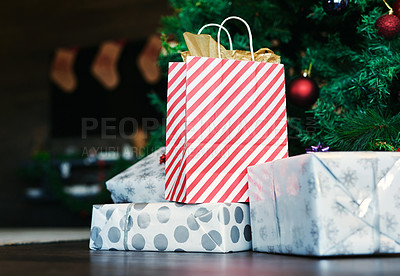 Buy stock photo Shot of presents under a Christmas tree at home