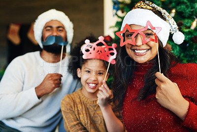 Buy stock photo Shot of a happy young family celebrating Christmas at home
