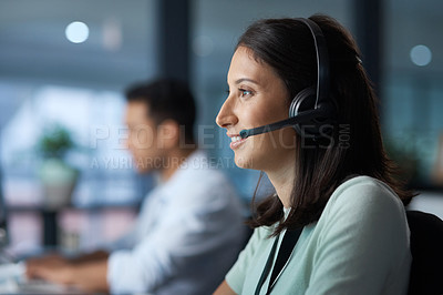 Buy stock photo Shot of a young woman using a headset in a modern office