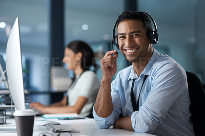 Buy stock photo Portrait of a young man using a headset and computer in a modern office