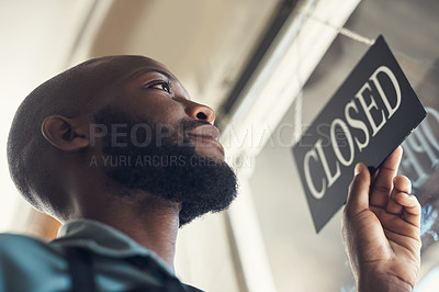 Buy stock photo Low angle shot of a handsome young man standing and turning the sign on the door to his bicycle shop