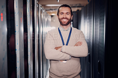 Buy stock photo Portrait of an attractive young man with folded arms while at work in a server room