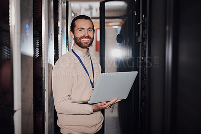 Buy stock photo Portrait of a young man using a laptop in a server room at work