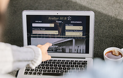 Buy stock photo Cropped shot of an unrecognizable woman sitting and searching for new properties on her laptop