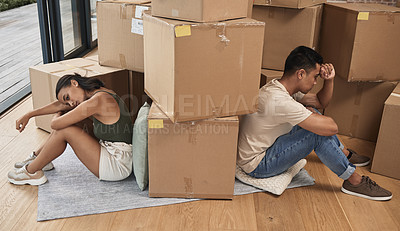 Buy stock photo Shot of a young couple ignoring one another at home