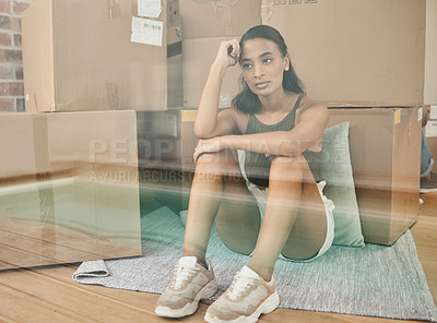 Buy stock photo Shot of a young woman being upset while sitting on the floor at home