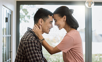 Buy stock photo Shot of a couple spending time together in the kitchen at home