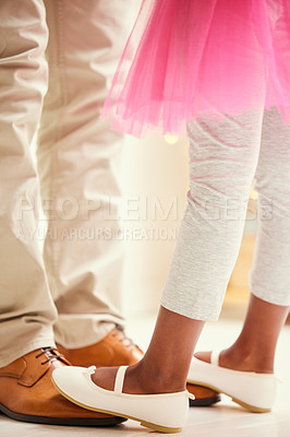Buy stock photo Shot of a unrecognizable girl dancing on her father's feet at home