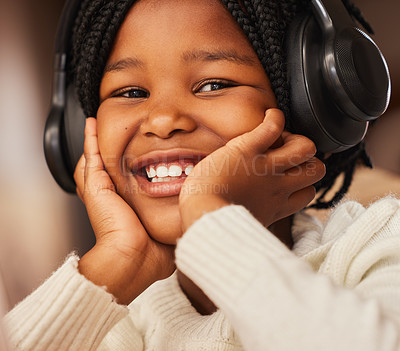 Buy stock photo Shot of a little girl wearing headphones at home