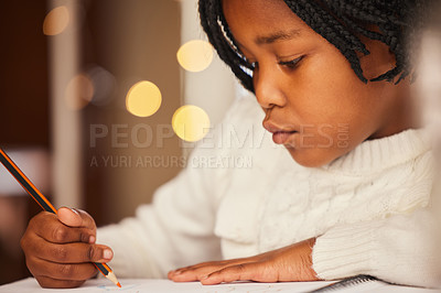 Buy stock photo Shot of a little girl drawing at home