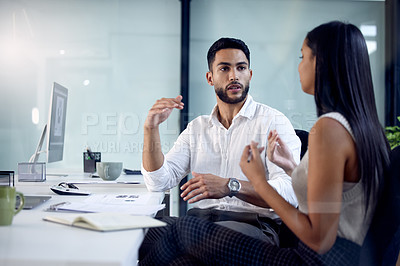 Buy stock photo Shot of two business colleagues working together