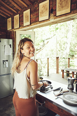 Buy stock photo Shot of a young woman preparing a meal