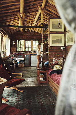 Buy stock photo Shot of a young woman busy in a cabin