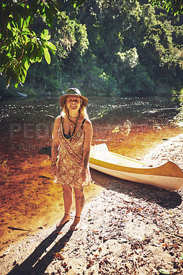 Buy stock photo Shot of a young woman out by the lake with a kayak