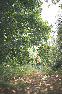 Buy stock photo Shot of a young woman out exploring nature