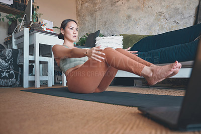 Buy stock photo Shot of a young woman exercising at home