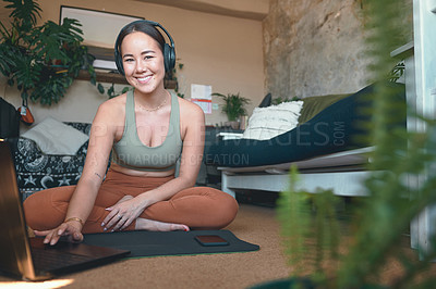 Buy stock photo Portrait of a young woman using a laptop while exercising at home