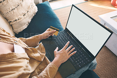 Buy stock photo Shot of an unrecognisable woman using a laptop and credit card on the sofa at home