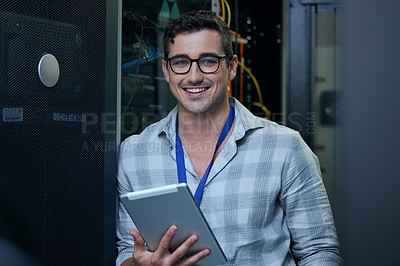 Buy stock photo Cropped portrait of a handsome young male programmer working on a tablet in a server room