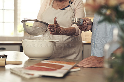 Buy stock photo Shot of an unrecognizable couple baking together at home