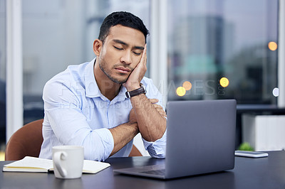 Buy stock photo Shot of a businessman looking exhausted at work