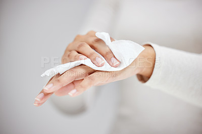 Buy stock photo Shot of an unrecognizable person using a wipe to clean their hands