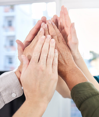 Buy stock photo Shot of a group of colleagues high fiving each other