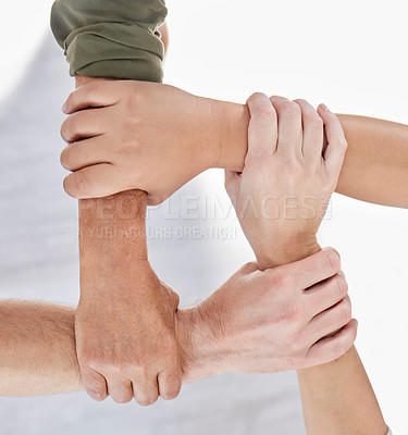 Buy stock photo Shot of a group of colleagues holding arms