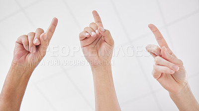 Buy stock photo Shot of a group of coworkers with their hands raised