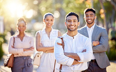 Buy stock photo Shot of a diverse group of businesspeople standing together in the city after a day in the office