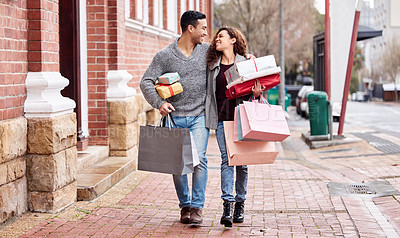 Buy stock photo Full length shot of an affectionate young couple enjoying a shopping spree in the city