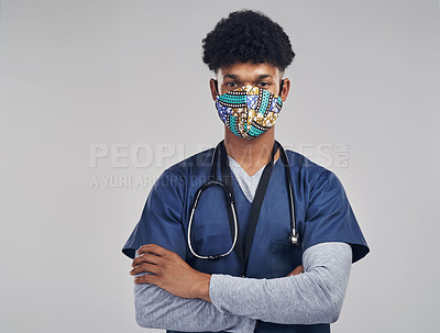 Buy stock photo Shot of a male nurse wearing a mask while standing against a grey background