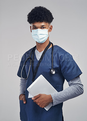 Buy stock photo Shot of a male nurse holding a digital tablet while standing against a grey background