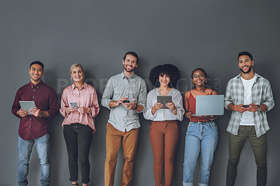 Buy stock photo Studio portrait of a diverse group of people standing together against a grey background
