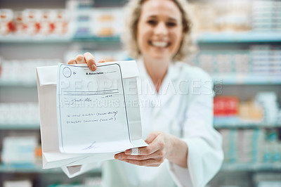 Buy stock photo Cropped portrait of an attractive young female chemist handing you your medication in the pharmacy