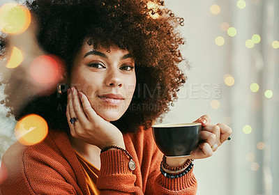 Buy stock photo Shot of a young woman enjoying a cup of coffee in a cafe