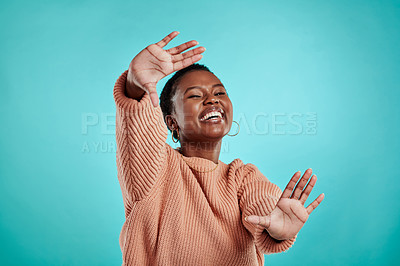 Buy stock photo Studio shot of a young woman forming a frame with her hands